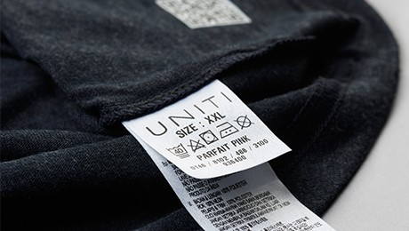 Close-up of a printed fabric label washing instruction