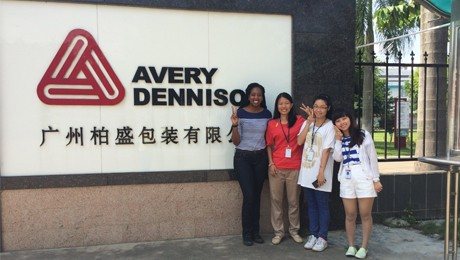 Group of women in front of Avery Dennison logo