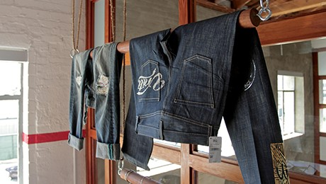 Denim jeans hanging in one of our customer design and innovation center