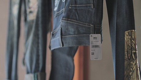 Denim jeans hanging with tag